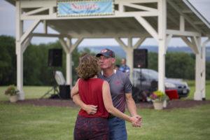 couple dancing at nautie summer nights at lucas vineyards